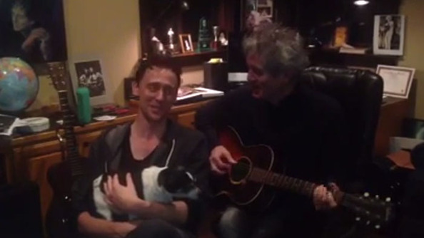 From Us to You, Hiddles Singing a Christmas Carol With an Adorable Dog on His Lap
